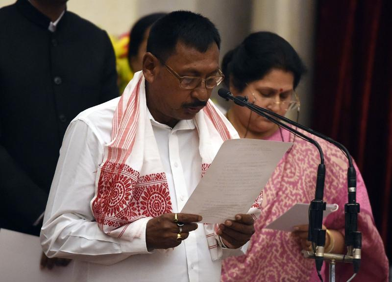 Bhartiya Janata Party (BJP) Leader Rajen Gohain takes the oath as minister of state. (AFP)