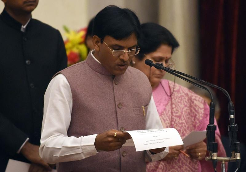 Bharatiya Janata Party (BJP) politician, Mansukh Mandaviya takes the oath as minister of state. (AFP)
