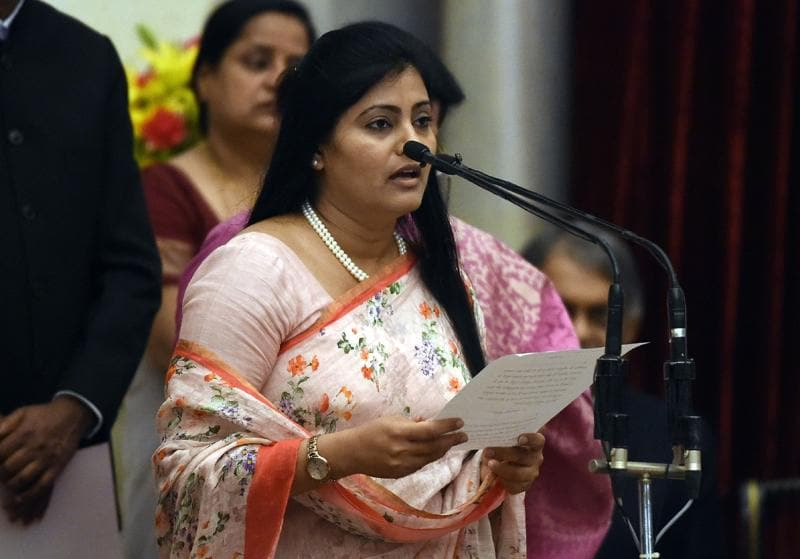 Bharatiya Janata Party (BJP) politician, Anupriya Singh Patel takes the oath as minister of state. (AFP)