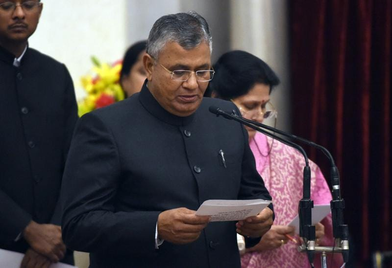 Bharatiya Janata Party (BJP) politician, P P Chaudhary takes the oath as minister of state. (AFP)