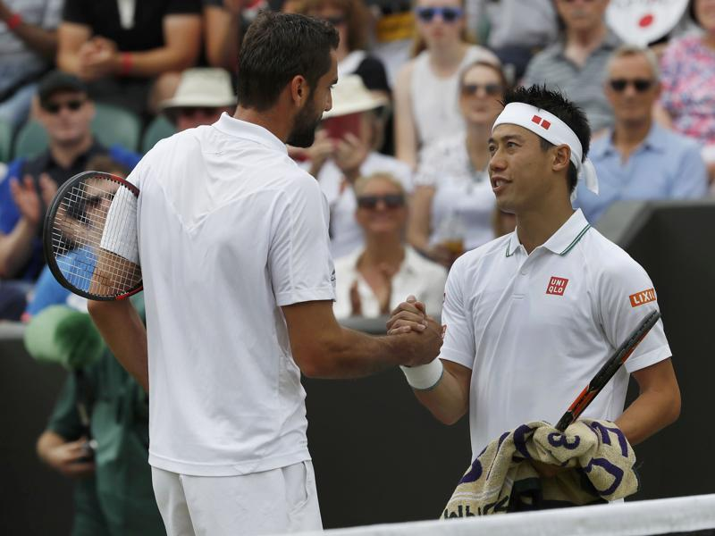Japan's Kei Nishikori with Croatia's Marin Cilic after retiring during the match due to injury. (Reuters Photo)