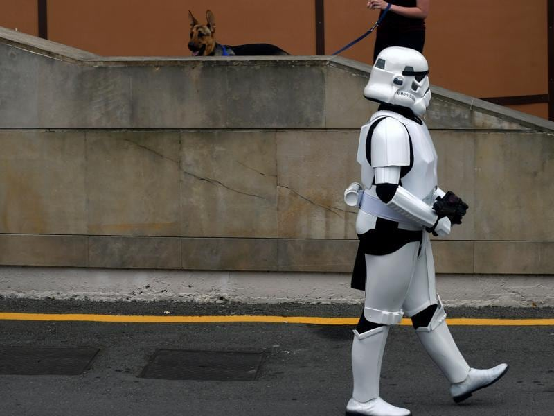 A person wearing a Star Wars stormtrooper costume walks during the parade. (REUTERS)