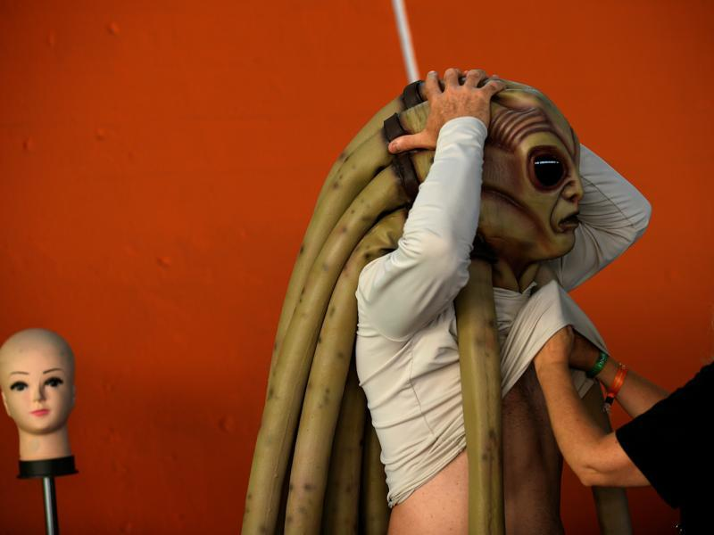 A cosplayer prepares before the start of the parade during the Metropoli. (REUTERS)