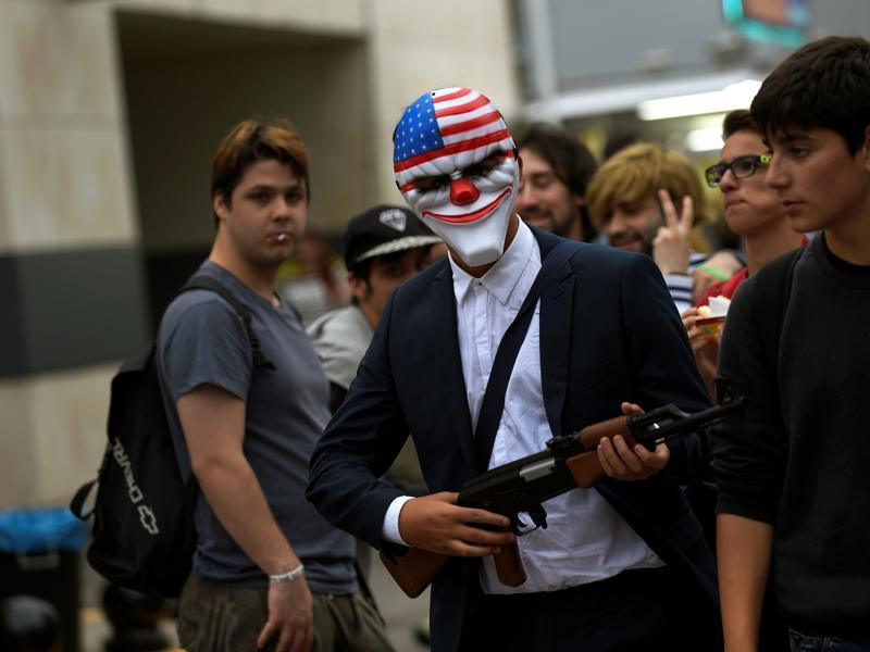 A person wearing a mask walks during the parade.  (REUTERS)