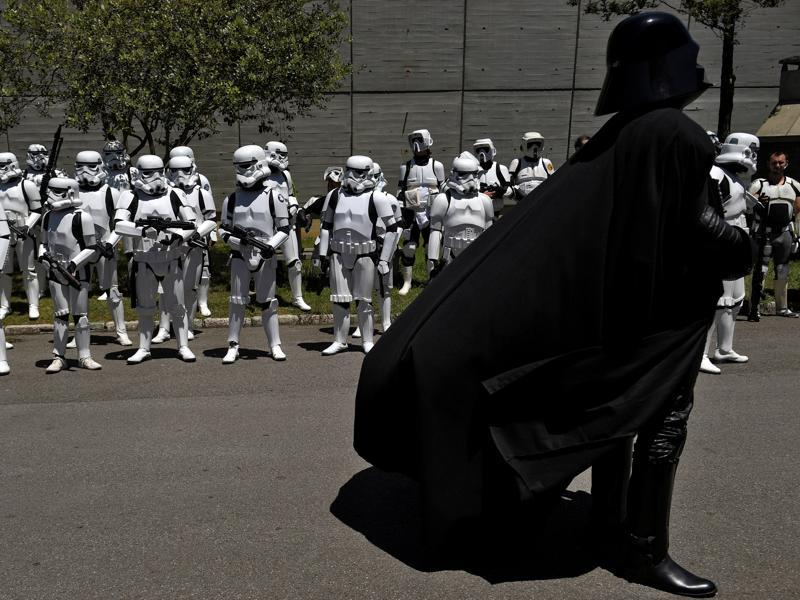 People wearing Star Wars costumes at the parade in Metropoli. (REUTERS)