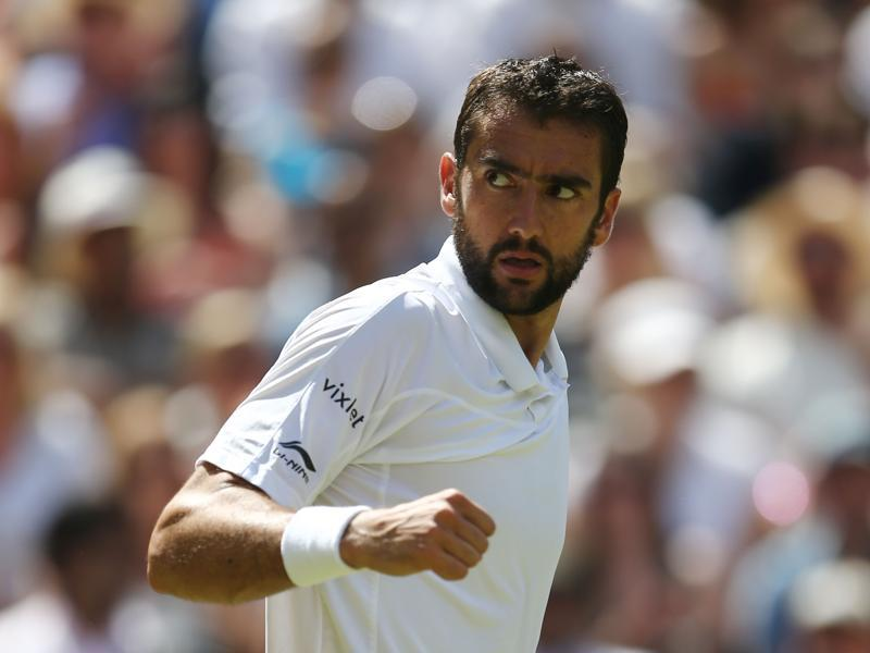 Cilic celebrates winning the second set. (AFP)