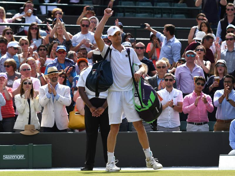 Sam Querrey walks off court after losing to Milos Raonic. (AFP)