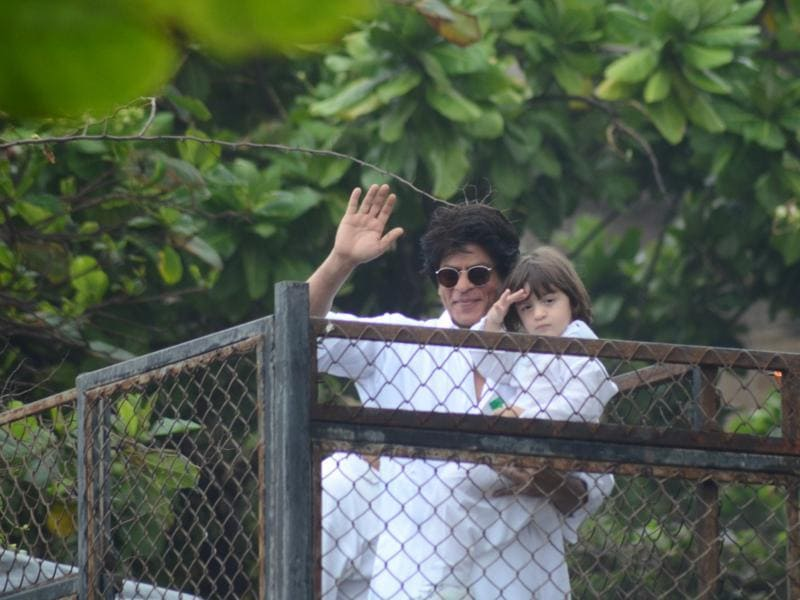 Shah Rukh Khan and his son AbRam greet fans at Mannat, SRK's house in Mumbai on the occasion of Eid on Thursday. (Viral Bhayani)