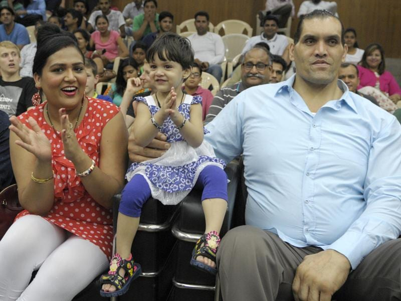 Wrestling-entertainment star Dalip Singh Rana, better known as The Great Khali, with his wife Harminder Kaur and four-year-old daughter Avleen at the opening of a badminton tournament in Chandigarh on Wednesday. (Anil Dayal/HT Photo)