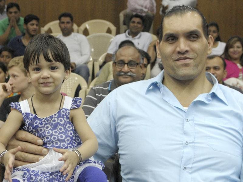 Dalip Singh Rana, better known as The Great Khali, with his daughter Avleen at the opening of a badminton tournament in Chandigarh on Wednesday. (Anil Dayal/HT Photo)