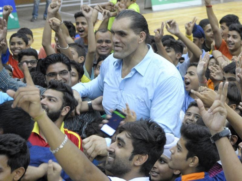 Dalip Singh Rana, or The Great Khali, with fans at the opening of a badminton tournament in Chandigarh on Wednesday. (Anil Dayal/HT Photo)