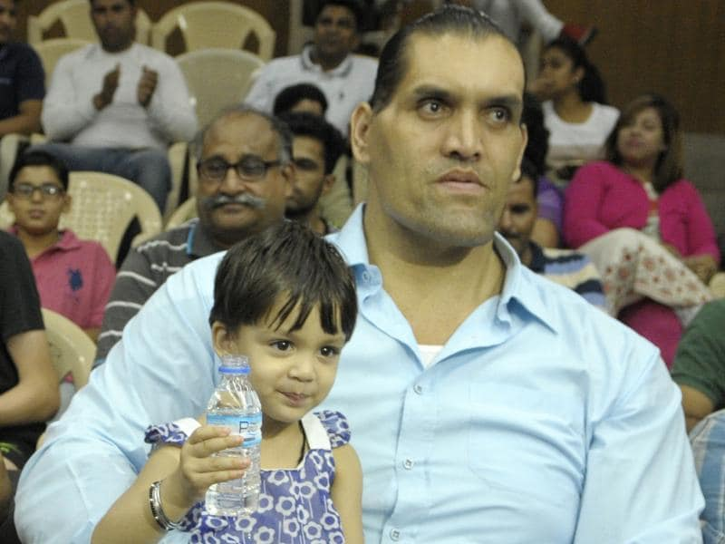Wrestling-entertainment star Dalip Singh Rana, better known as The Great Khali, with his daughter Avleen at the opening of a badminton tournament in Chandigarh on Wednesday. (Anil Dayal/HT Photo)