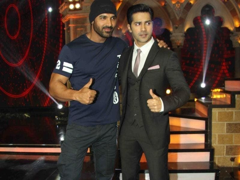 John Abraham and Varun Dhawan pose for the shutterbugs on the sets of India's Got Talent 7 finale. (IANS Photo)