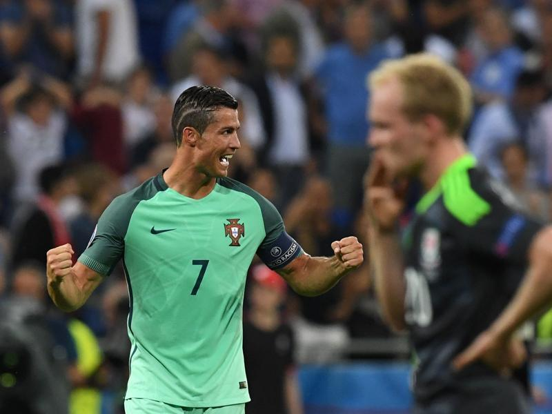 Ronaldo (left) celebrates at the end of the Euro 2016 semifinal football match against Wales. (AFP Photo)