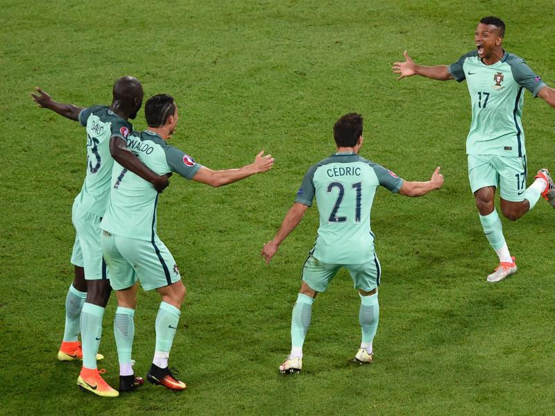 Nani (right) celebrates scoring a goal with team mates during the Euro 2016 semifinal against Wales. (AFP Photo)
