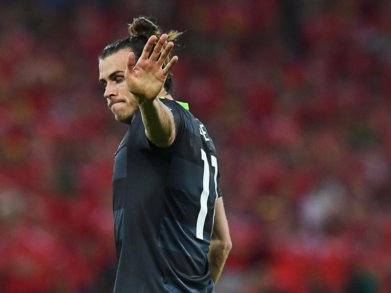 Wales' forward Gareth Bale reacts during the Euro 2016 semifinal football match between Portugal and Wales. (AFP Photo)