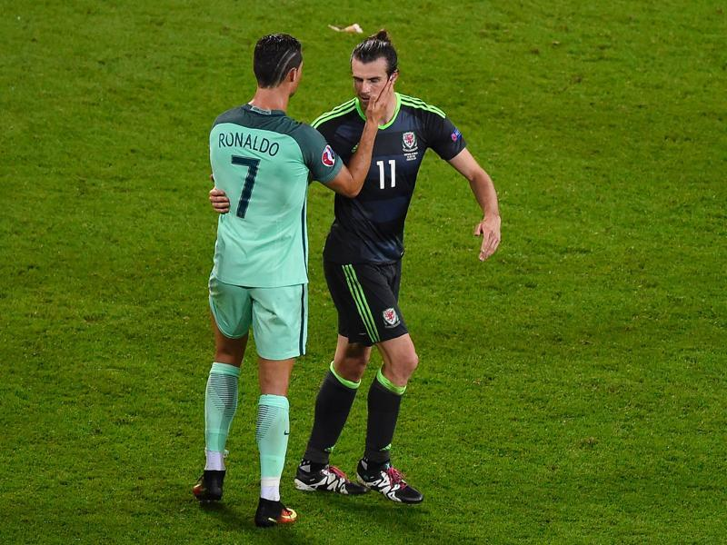 Cristiano Ronaldo (left) comforts Gareth Bale after Portugal defeated Wales 2-0 in the Euro 2016 semifinal.  (AFP Photo)