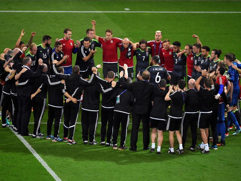 Wales' players stand together after the Euro 2016 semifinal football match between Portugal and Wales at the Parc Olympique Lyonnais stadium. (AFP)