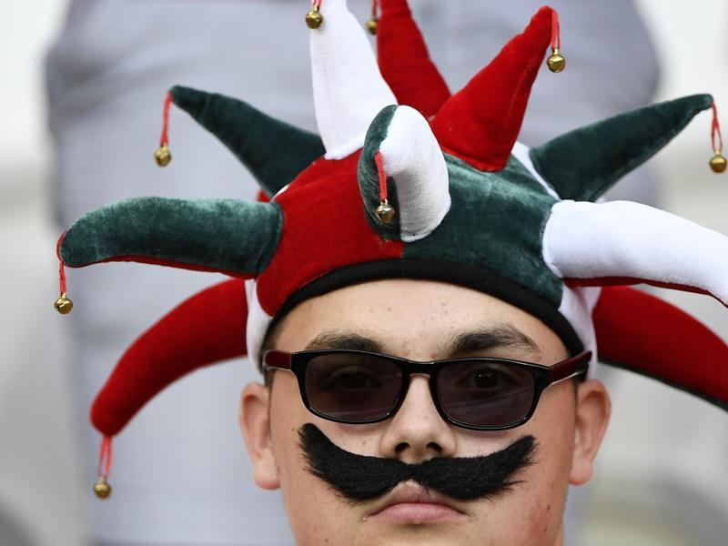 A Portugal fan waits for the start of the Euro 2016 semifinal football match between Portugal and Wales at the Parc Olympique Lyonnais stadium, near Lyon. (AFP Photo)