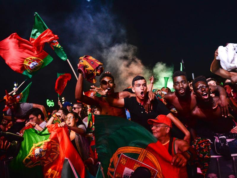 Portugal football team's supporters celebrate their 2-0 victory after watching the Euro 2016 semifinal football match against Wales. (AFP Photo)