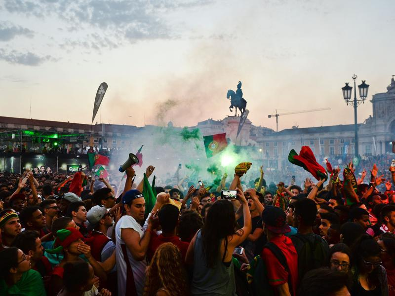 Portugal football team's supporters react after the team's first goal as they watch the Euro 2016 semifinal between Portugal vs Wales, displayed on a giant screen at Terreiro do Paco square in Lisbon. (AFP Photo)