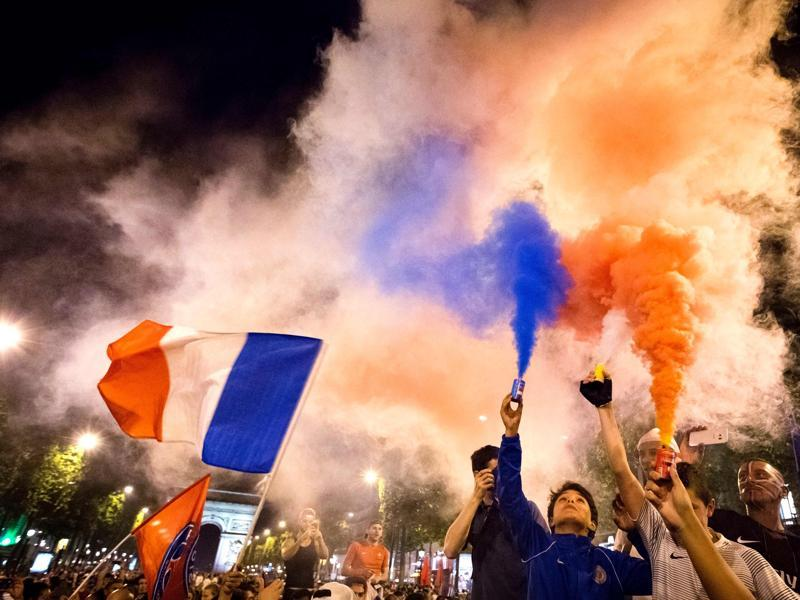 France supporters celebrate with smoke flares after France won the Euro 2016 semifinal. (AFP Photo)