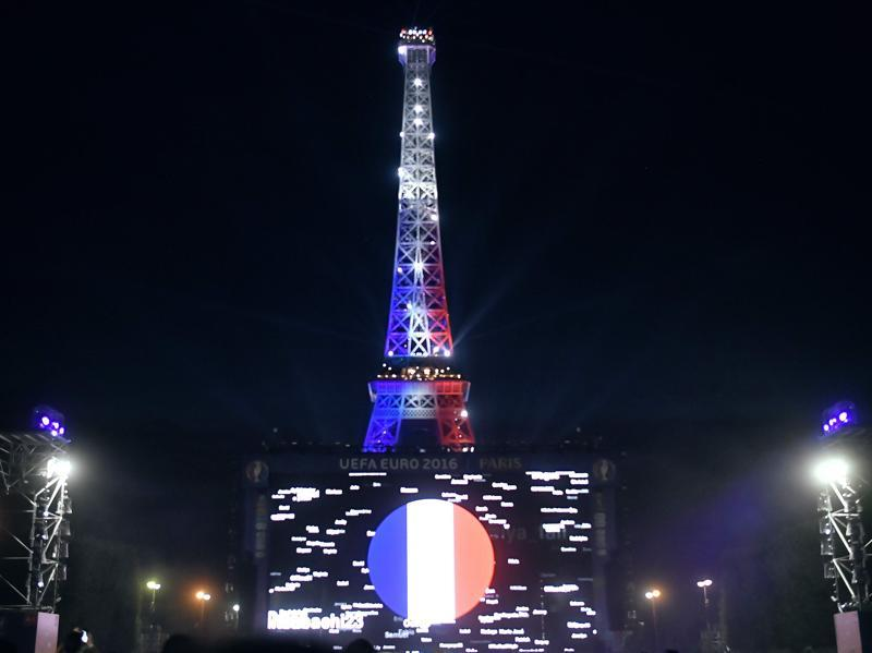 Eiffel Tower is lit with the colours of the French national flag after France won the Euro 2016 semifinal football match against Germany at the Paris Champs de Mars fan zone.  (AFP Photo)