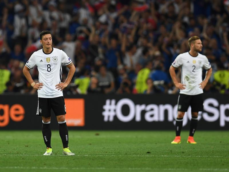 Germany's Mesut Ozil (left) and Shkodran Mustafi react after France's forward Antoine Griezmann (unseen) scores the second goal for France. (AFP Photo)