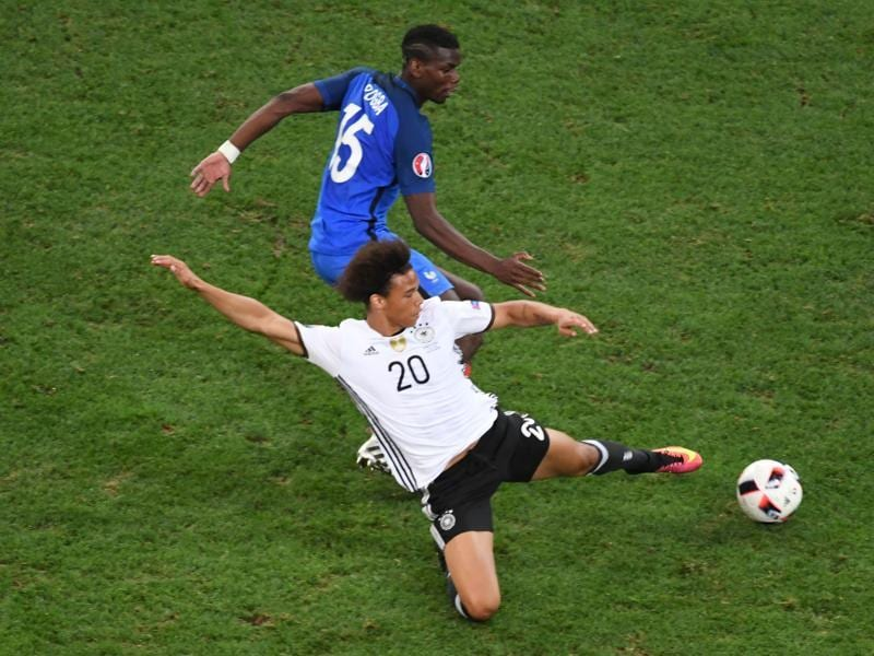 Germany's midfielder Leroy Sane (front) vies for the ball with France's midfielder Paul Pogba. (AFP Photo)