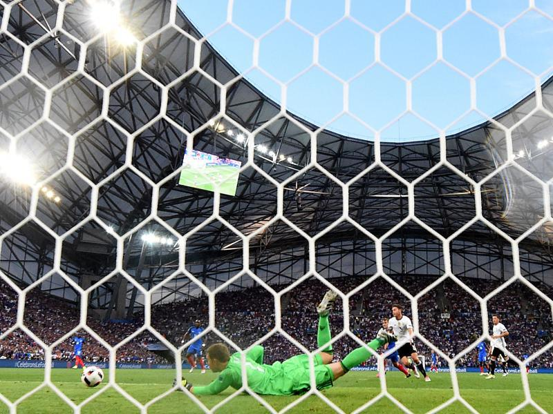 Germany's goalkeeper Manuel Neuer blocks a shot on goal during the Euro 2016 semifinal football match between Germany and France at the Stade Velodrome in Marseille. (AFP Photo)