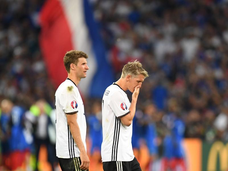 Germany's midfielder Thomas Mueller and midfielder Bastian Schweinsteiger leave the pitch after loosing 2-0 to France in the Euro 2016 semifinal football match between Germany and France. (AFP Photo)
