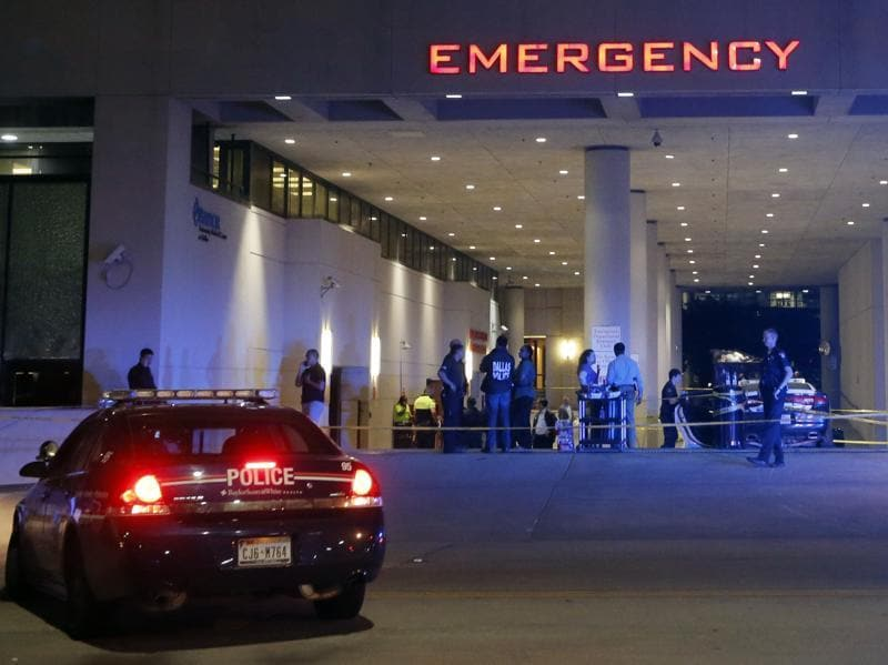 Law enforcement officers stand outside the emergency room at Baylor University Medical Center in Dallas. (AP Photo)