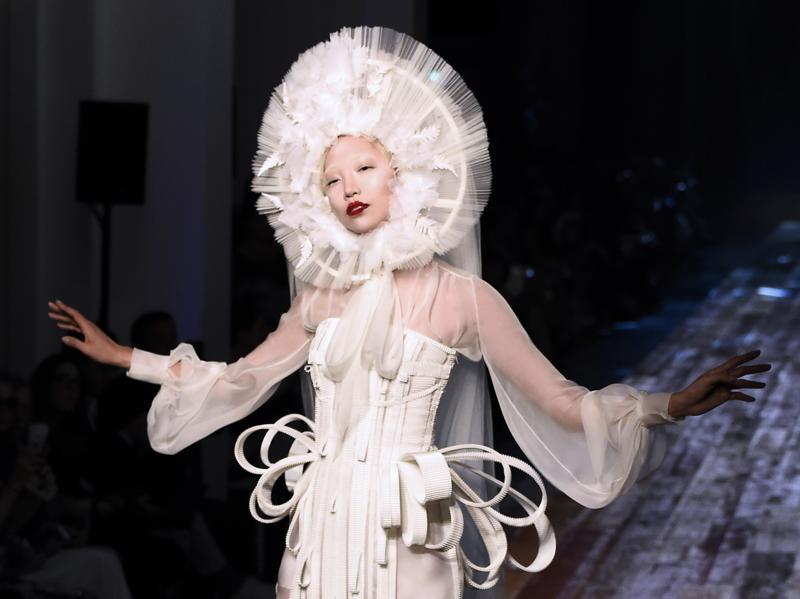 Jean Paul Gaultier: Jean Paul Gaultier drew inspiration from nature and from Japan for his latest haute couture collection, treating the audience to a Zen-filled ambiance. The designer's collection included some original headgear, which framed models' faces. (AFP)