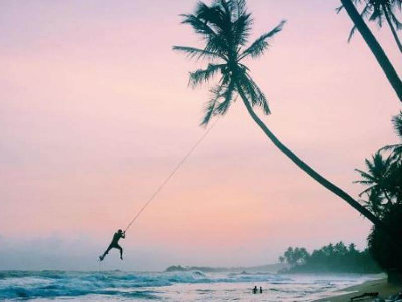 This week Instagrammers were asked to post photographs of iconic landmarks in a layered, unique way.  Swinging off a palm tree at the serene coast of Wijaya Beach in Sri Lanka. (Instagram/wanderlustgava)