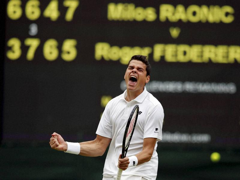 Milos Raonic of Canada celebrates after beating Roger Federer of Switzerland in their men's semifinal. (AP Photo)