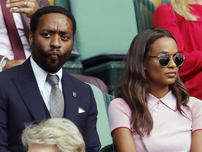 Actor Chiwetel Ejiofor and his girlfriend Frances Aaternir watch as Andy Murray plays Tomas Berdych. (AP)