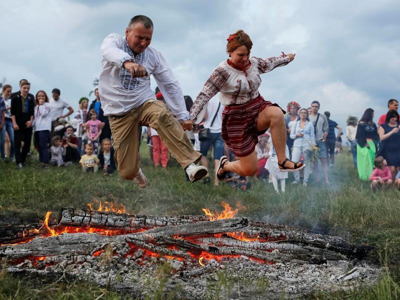 On Kupala day, young people jump over the flames of bonfires in a ritual test of bravery and faith. (REUTERS)