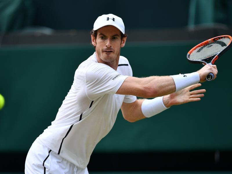 Britain's Andy Murray returns against Czech Republic's Tomas Berdych in their men's singles semifinal. (AFP Photo)