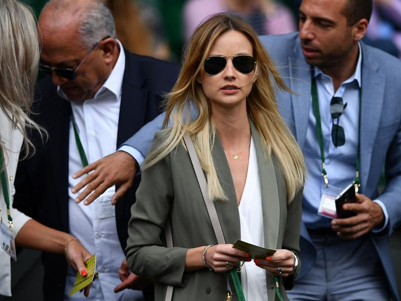 Czech model Ester Satorova, wife of Czech Republic's Tomas Berdych, arrives on centre court to watch the men's singles semifinal. (AFP Photo)