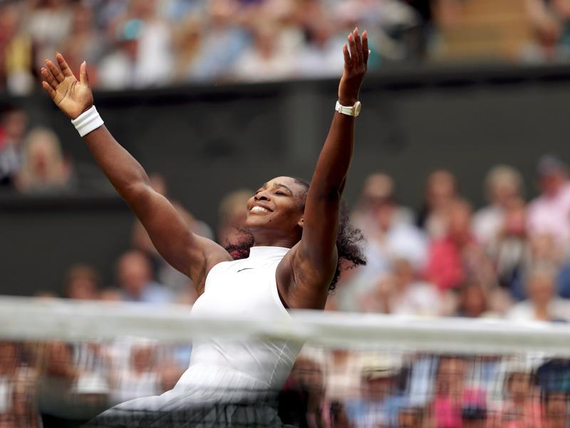 Serena celebrates her win, which gave her a 22nd Grand Slam and seventh at Wimbledon, equalling Steffi Graf's Open Era record. (REUTERS)