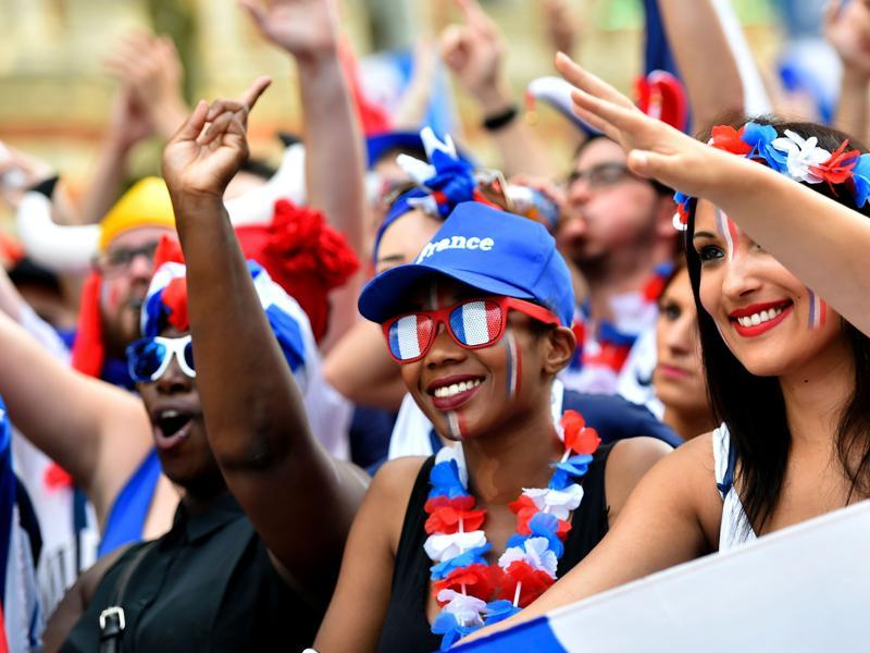 France supporters cheer  trendy glasses and flower crowns. (AFP PHOTO)