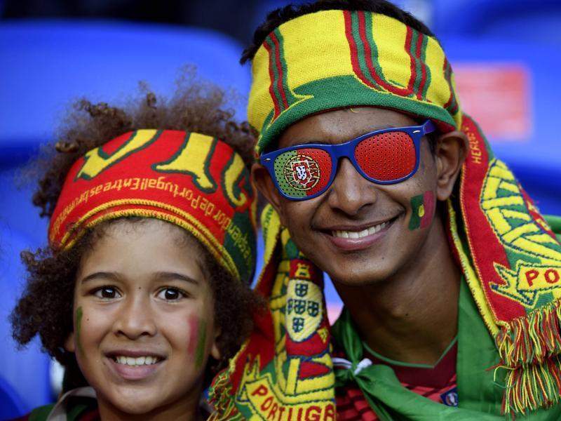 Portugal fans are ready with fan memorabilia. (AFP PHOTO)