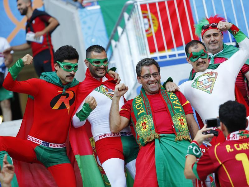Portugal's fans are ready with their Robin and Supermen gear to cheer in comical style. (REUTERS PHOTO)