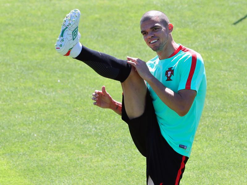 Portugal's Pepe stretches during a training session and is ready to play in the upcoming final. (AP photo)