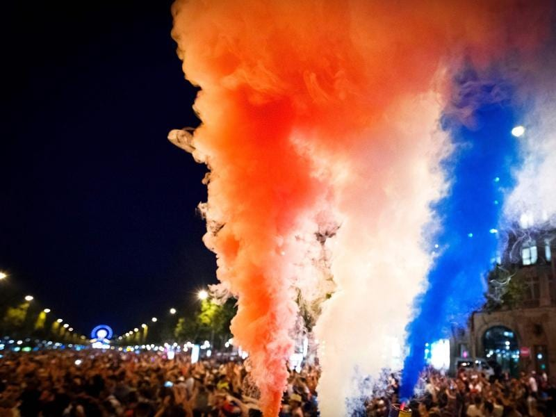 France supporters celebrate with smoke flares . (AFP PHOTO)