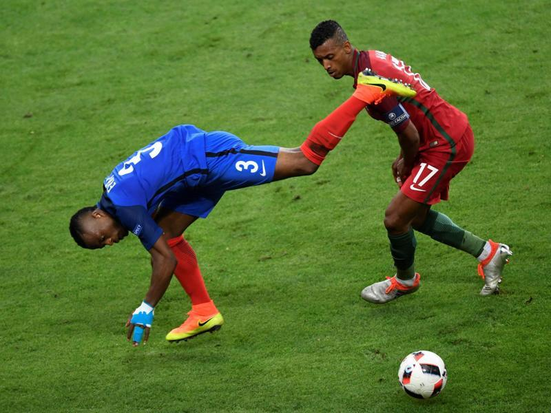 France's defender Patrice Evra (L) and Portugal's forward Nani vie for the ball during the Euro 2016 final. (AFP Photo)