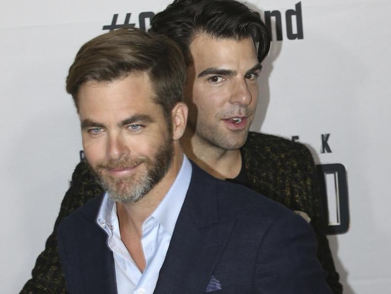 BFFs forever: Chris Pine and Zachary Quinto pass each other as they walk the red carpet during the premier of Star Trek Beyond in Sydney, Australia. (AP)