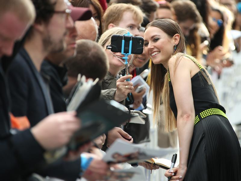 Actor Lydia Wilson poses for a selfie with a fan at the red carpet premiere of the Star Trek Beyond in London. (Joel Ryan/Invision/AP)