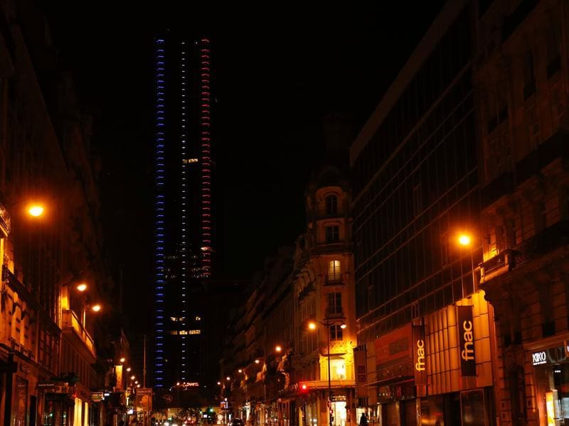 The Montparnasse Tower, illuminated with the colours of the French national flag in tribute for the victims of the deadly Bastille Day attack in Nice in Paris. (AFP Photo)