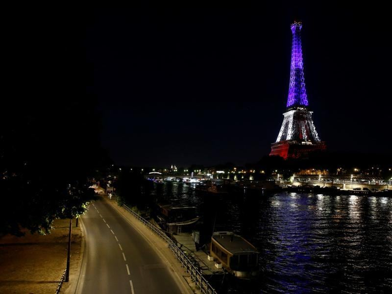 The Eiffel Tower illuminated with the colours of the French national flag in tribute for the victims of the deadly Bastille Day attack in Nice. (AFP Photo)